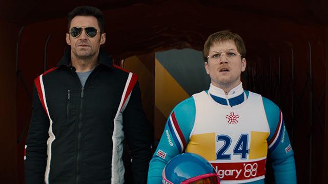 Hugh Jackman og Taron Egerton som en slags trener og en slags skihopper.
